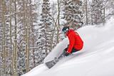 Snowboarder Enjoying Deep Fresh Powder at Brighton Ski Resort. Fotografisk tryk af Paul Kennedy
