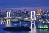 Rainbow Bridge Spanning Tokyo Bay with Tokyo Tower Visible in the Background. Photographic Print by  SeanPavonePhoto