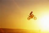 Silhouette of Motocross Race in mid Air, Sunset, Side View Valokuvavedos tekijänä John P Kelly