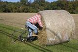 Bike Riding into Hay Bail Photographic Print