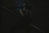Young Man Posing in Dark Setting Reproduction photographique par Luis Beltran