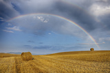 Rainbow over Harvested Wheat Field, Summer. Photographic Print by Martin Ruegner