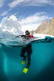 Diver in Front of an Iceberg, Astrolabe Island, Antarctic Peninsula, Antarctica Fotografisk tryk