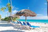 Beautiful Caribbean Beach with Chaise Lounge in Dominican Republic Photographic Print by  haveseen