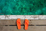 Sandals at Jetty by the Sea Photographic Print by  haveseen