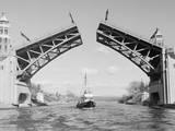 Boat Passing beneath Montlake Bridge Photographic Print by Ray Krantz