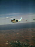 Cessna 210 Centurion Flying Photographic Print