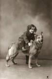 Studio Portrait, Child Sitting on Back of Dog, France Reproduction photographique