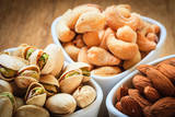 Varieties of Nuts: Cashew, Pistachio, Almond. Photographic Print by  Voy
