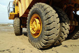 Tires on Construction Vehicle Photographic Print by Chris Henderson