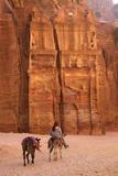 Bedouin Riding Donkey in the Siq, Petra, UNESCO World Heritage Site, Jordan, Middle East Stampa fotografica di Neil Farrin