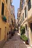 Narrow Street with Lady Sweeping, Old Town, Corfu Town Photographic Print by Eleanor Scriven