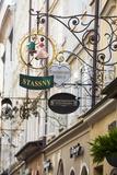 Ornate Shop Signs on Getreidegasse, Salzburgs Bustling Shopping Street, Salzburg Photographic Print by Doug Pearson