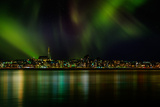 Aurora Borealis or Northern Lights over Reykjavik Skyline, Reykjavik, Iceland Photographic Print by Green Light Collection