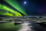 Moon and Aurora Borealis, Northern Lights with the Moon Illuminating the Skies and Icebergs Trykk på strukket lerret