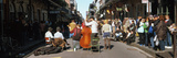 Spectator Looking at Street Musician Performing, Bourbon Street, New Orleans, Louisiana, USA Photographic Print by  Panoramic Images