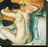 Woman Combing her Hair Stretched Canvas Print by Edgar Degas