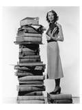 Woman With Pile Of Large Books Julisteet