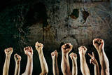 Arms Raised in Protest on a Grunge Background Photographic Print by  soupstock