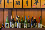 Sake Bottles in a Sake Brewery, Takayama, Gifu Prefecture, Japan Photographic Print by Stefano Politi Markovina