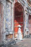 Woman Wearing Ao Dai Dress at Dien Tho Inside Citadel, Hue, Thua Thien-Hue, Vietnam (Mr) Photographic Print by Ian Trower