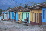 Cuba, Trinidad, a Man Selling Sandwiches Up a Colourful Street in Historical Center Fotografie-Druck von Jane Sweeney