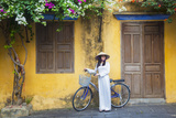 Woman Wearing Ao Dai Dress with Bicycle, Hoi An, Quang Ham, Vietnam Photographic Print by Ian Trower