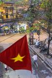 Vietnamese Flag and Street Scene, Hanoi, Vietnam Photographic Print by Peter Adams