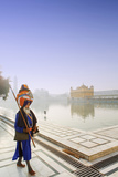 India, Punjab, Amritsar, a Sikh Pilgrim Carrying a Barcha Spear Photographic Print by Alex Robinson