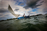 A Man Sails a Boat Off the Cayman Islands in the Caribbean Reproduction photographique par Chris Bickford