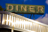 An Old Neon Diner Sign Above Glistening Reflective Aluminum Siding Photographic Print by Stephen St. John