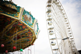 A Swing Ride and a Ferris Wheel in Paris, France Reproduction photographique par Chris Bickford