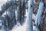 A Man Ice-Climbing Fotografisk tryk af Keith Ladzinski