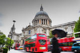 St Paul's Cathedral in London, the Uk. Red Buses in Motion and Man Walking with Umbrella. Reproduction photographique par Michal Bednarek