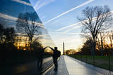 Washington DC - A Veteran Looks for a Name at Vietnam Veterans Memorial Wall at Sunrise Photographic Print by  Orhan