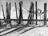 Skis Leaning Against a Fence in the Snow Stretched Canvas Print by Dusan Stanimirovitch