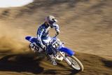 Motocross Racer on Dirt Track Photo