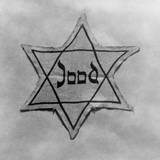 Yellow and Black Star Which the Jews Were Required to Wear in Occupied Holland During World War 2 Foto