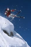 Skier in Mid-Air Above Snow on Ski Slopes Foto