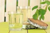 Glasses of Birch Sap on Green Wooden Table Valokuvavedos tekijänä Africa Studio