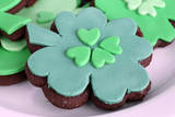 Cookies in Shape of Four Clover Leaf for St Patrick Day Valokuvavedos tekijänä Africa Studio