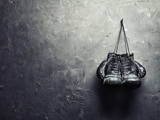 Old Boxing Gloves Hang on Nail on Texture Wall Premium-Fotodruck von  GVS