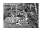 Iban Woman Making Thread with a Mangle, Borneo, 1922 Giclee Print by Charles Hose
