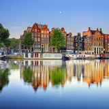 Netherlands, North Holland, Amsterdam. Typical Houses and Houseboats on Amstel River Photographic Print by Francesco Iacobelli