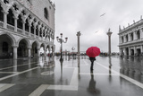 Italy, Veneto, Venice. Woman with Red Umbrella in Front of Doges Palace with Acqua Alta (Mr) Fotografisk trykk av Matteo Colombo