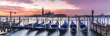 Italy, Veneto, Venice. Row of Gondolas Moored at Sunrise on Riva Degli Schiavoni Stretched Canvas Print by Matteo Colombo
