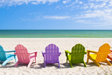 Adirondack Beach Chairs on a Sun Beach in Front of a Holiday Vac Stampa fotografica di Chad McDermott