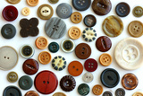 Collection Vintage Sewing Button Scattered on White Background Photographic Print by Christin Lola