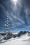 Bavarian Alps, Zugspitze, Germany and Maypole in Winter Vertical Photographic Print by Sheila Haddad