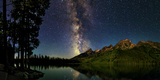 The Night Sky over a Lake in Grand Teton National Park Photographic Print by Babak Tafreshi